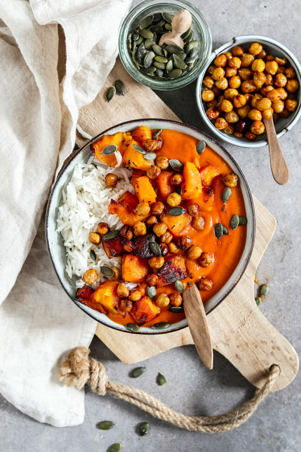 Creamy pumpkin curry served with rice, roasted pumpkin, crispy chickpeas and pumpkin seeds.