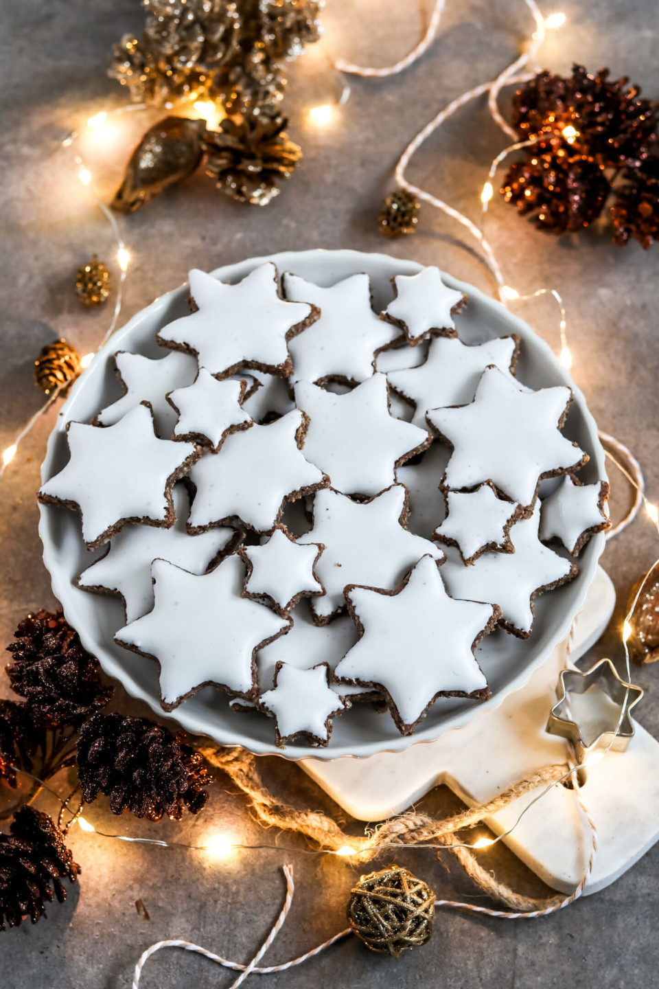 Vegan Cinnamon Stars served on a dessert plate with Christmas decoration.