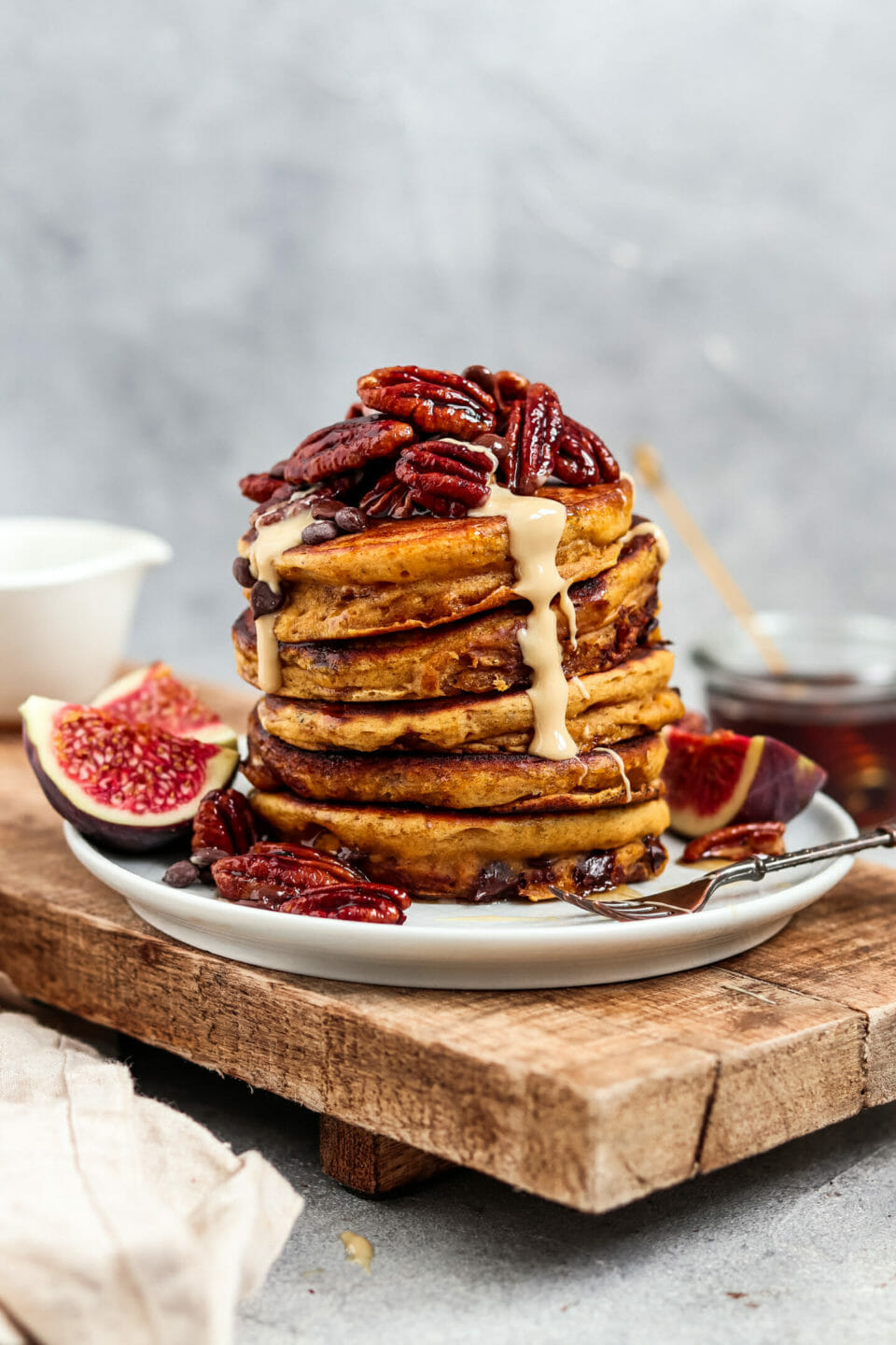 Chocolate Chip Pumpkin Pancakes with caramelized pecans and nut butter.