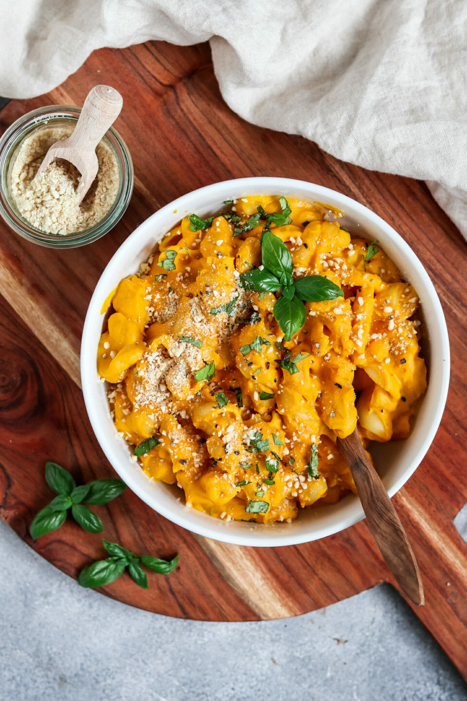 Vegan Pumpkin Mac and Cheese served with cashew parmesan.