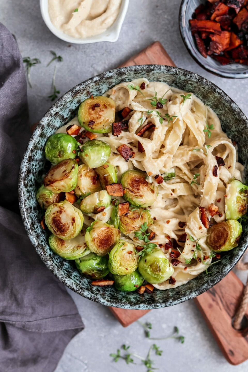 Vegan Fettuccine Alfredo with pan fried Brussel sprouts and coconut bacon.