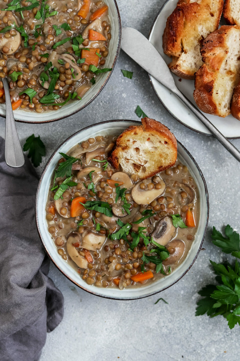 Vegan lentil stew with mushrooms and carrots.