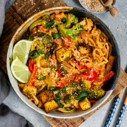 Vegan Thai Panang Curry in a deep bowl served on a wooden plate